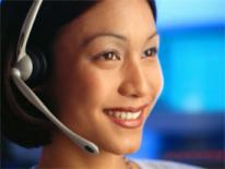 photo of person on headset answering phone